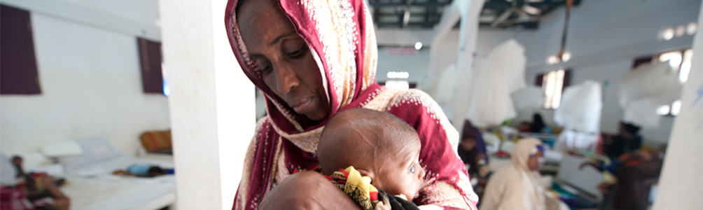 Somali woman cradles baby