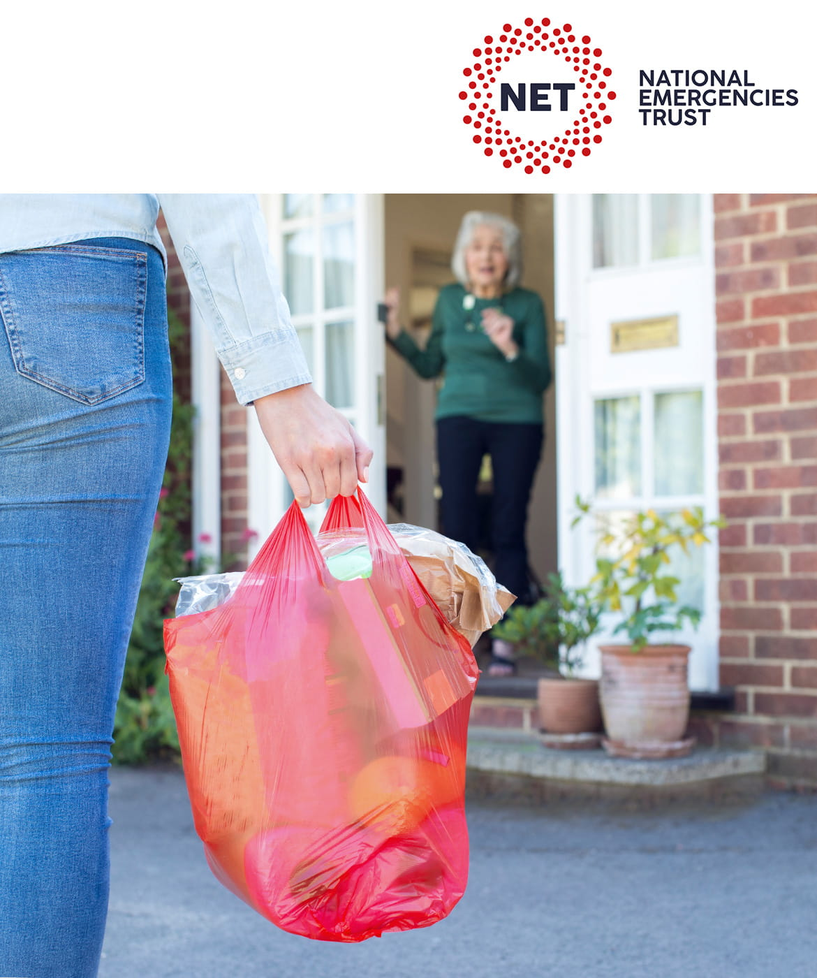 National Emergencies Trust: woman holding a bag of shopping, walking up to another woman's front door