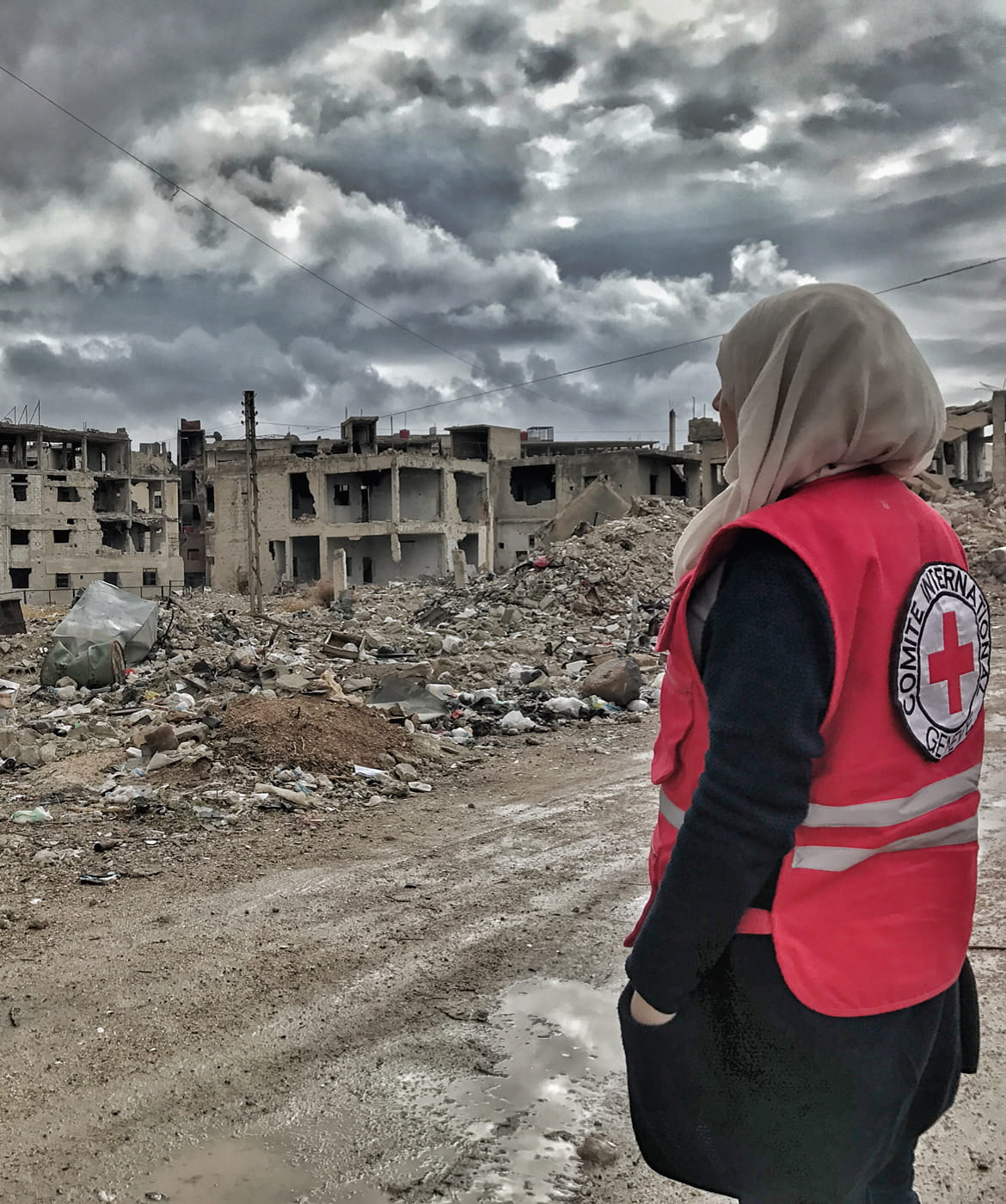 Red Cross volunteer is looking at vast destruction in Moadhmiya, Syria