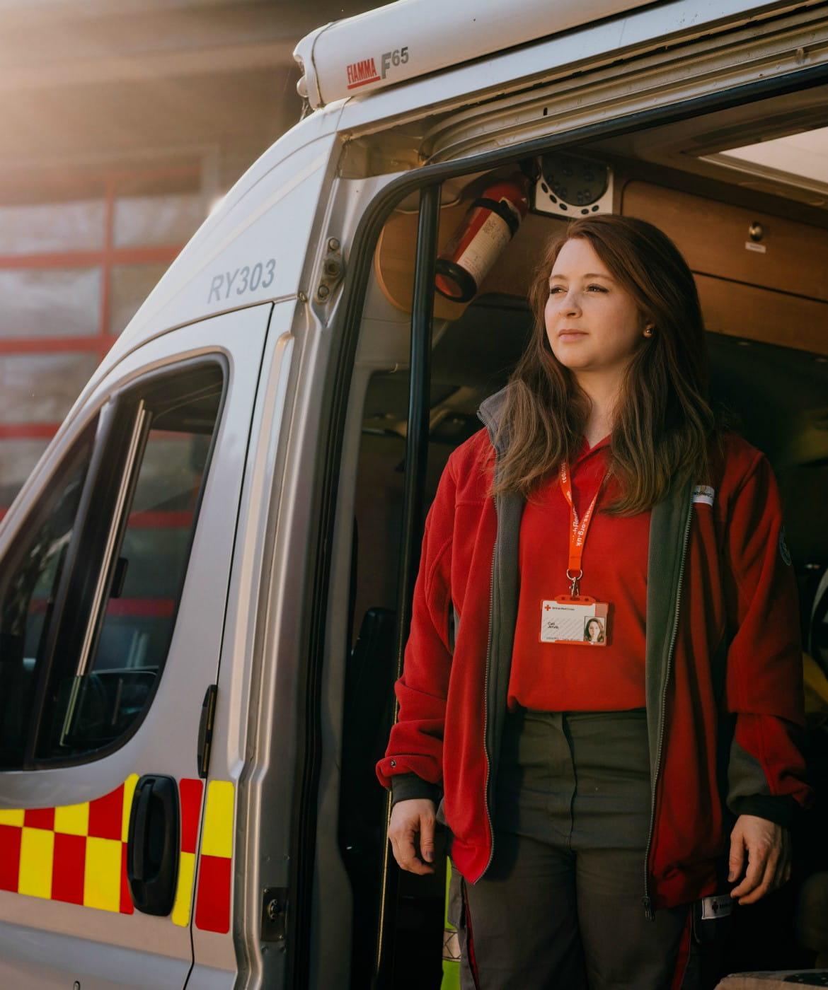 red cross volunteers in a car