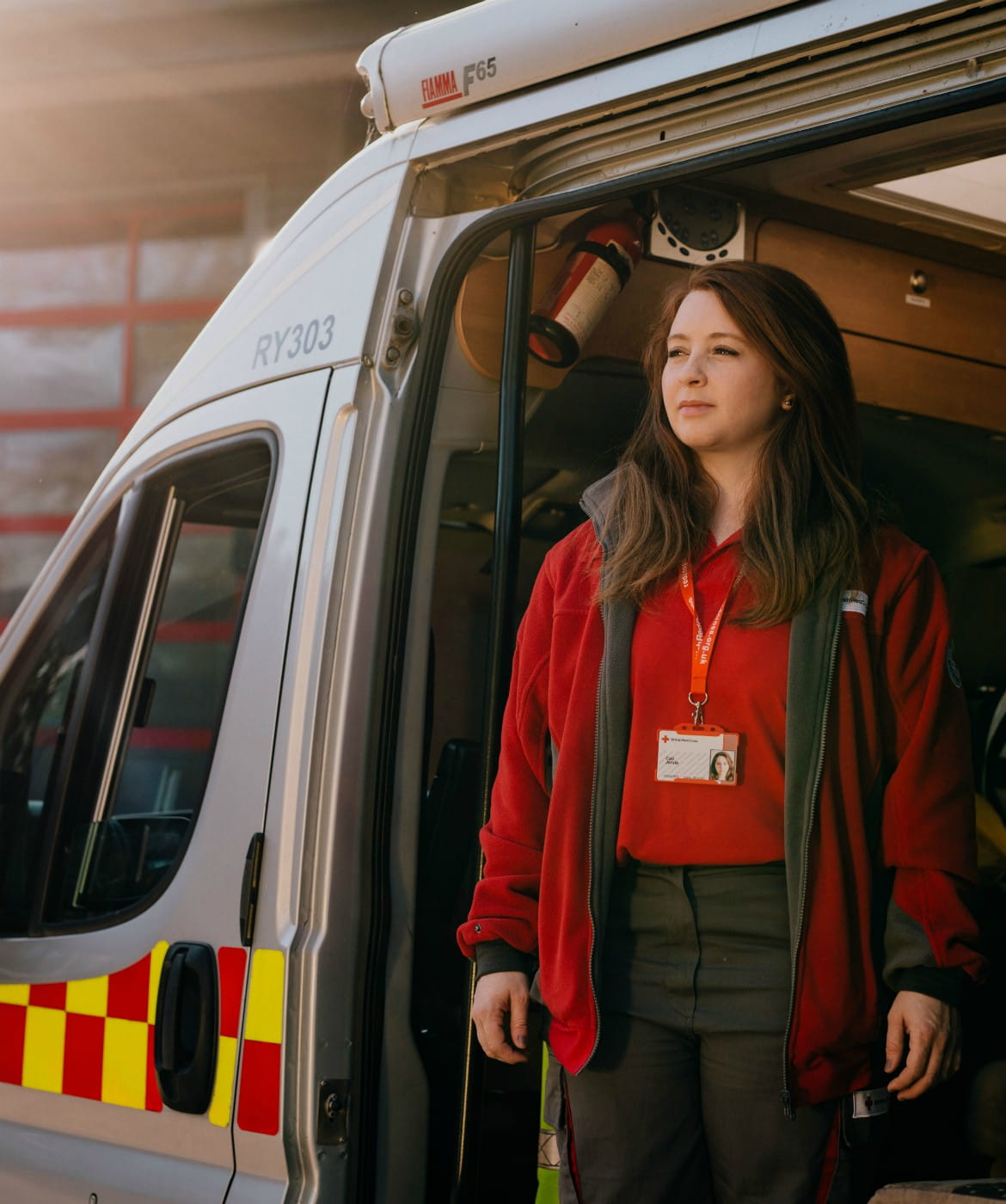 Red Cross Volunteer stands ready in Ambulance