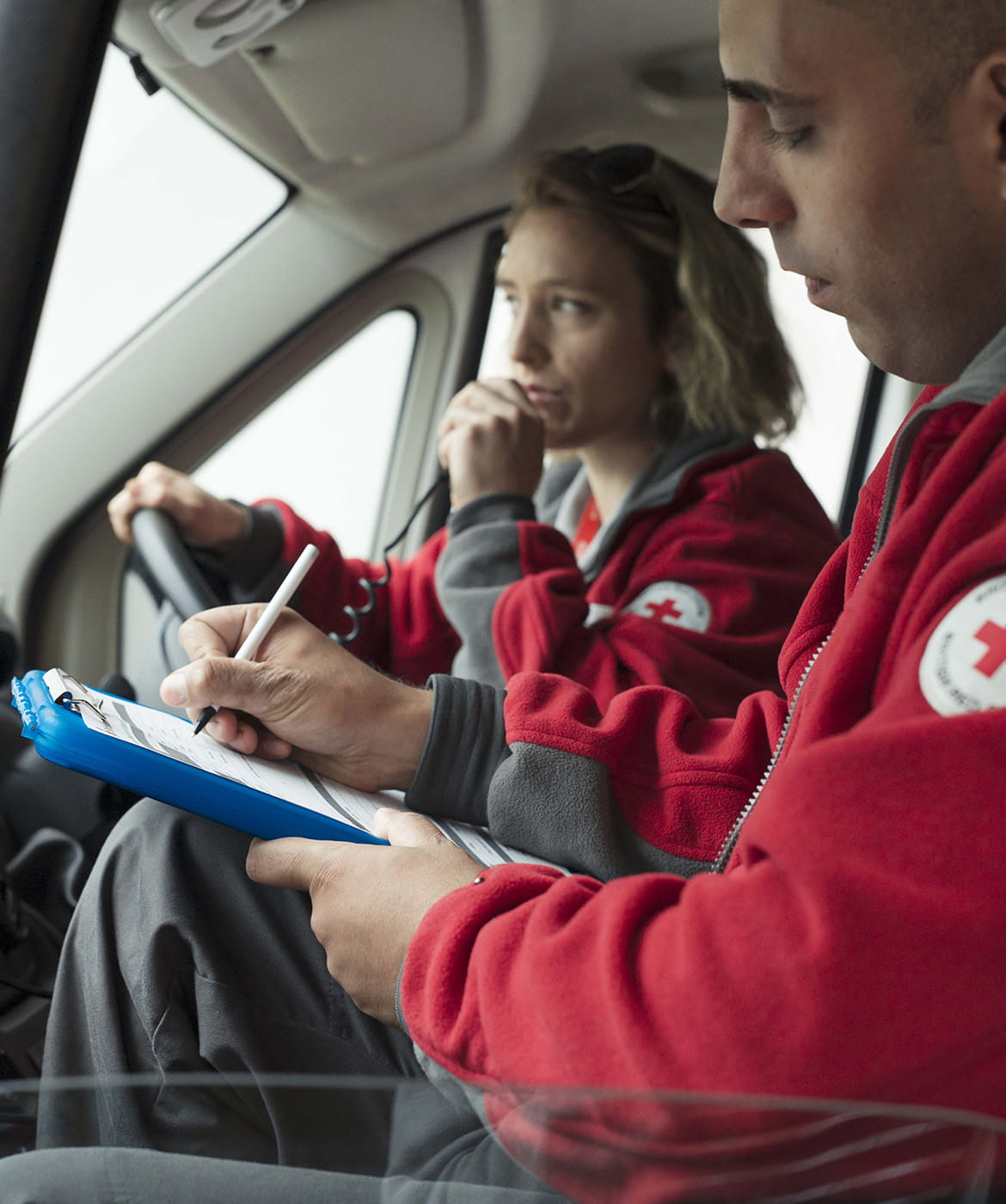 red cross volunteers in a car